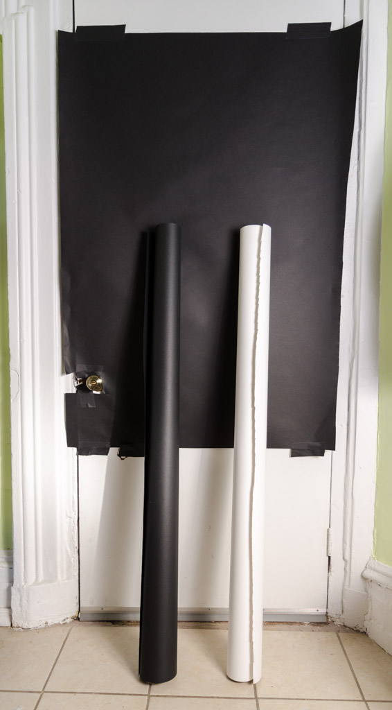 Roll of Black and White Seamless Paper - Black Paper Taped to Door